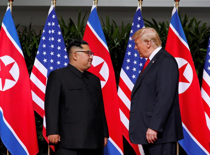 U.S. President Donald Trump and North Korea's leader Kim Jong Un meet at the Capella Hotel on the resort island of Sentosa, Singapore June 12, 2018. REUTERS/Jonathan Ernst