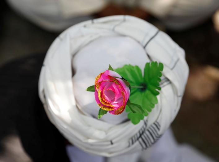 An artificial flower is seen on a turban of a peace marcher as he arrives in Kabul, Afghanistan June 18, 2018. REUTERS/Mohammad Ismail