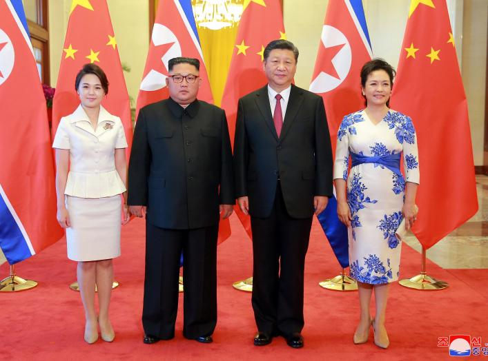 North Korean leader Kim Jong Un and his wife Ri Sol Ju pose beside Chinese President Xi Jinping and his wife Peng Liyuan in Beijing, China, in this undated photo released June 20, 2018 by North Korea's Korean Central News Agency.