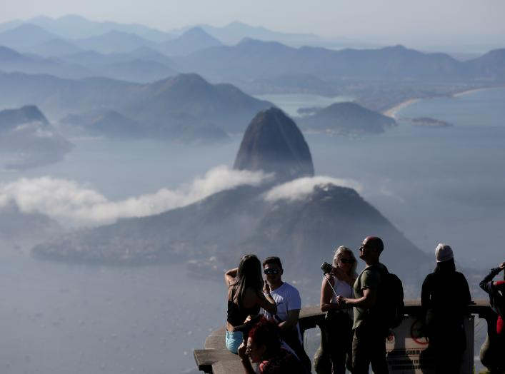 Tourists are seen with the Sugarloaf Mountain in the background in Rio de Janeiro, Brazil June 21, 2018. REUTERS/Bruno Kelly