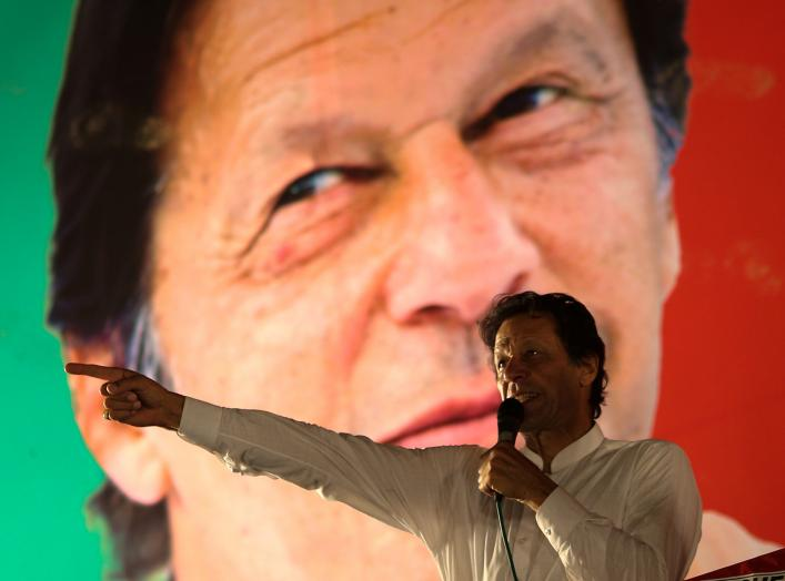 Imran Khan, chairman of the Pakistan Tehreek-e-Insaf (PTI) gestures while addressing his supporters during a campaign meeting ahead of general elections in Islamabad, Pakistan, July 21, 2018. REUTERS/Athit Perawongmetha