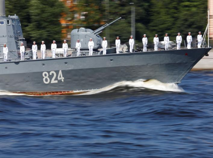 A Russian warship sails along the Neva River during the Navy Day parade in St Petersburg, Russia, July 29, 2018. REUTERS/Anton Vaganov