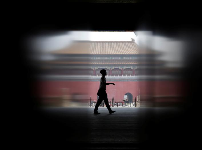 A security guard walks at the Gate of Supreme Harmony, in a part where it is closed for a major renovation work, at the Forbidden City in central Beijing, China July 31, 2018. REUTERS/Jason Lee