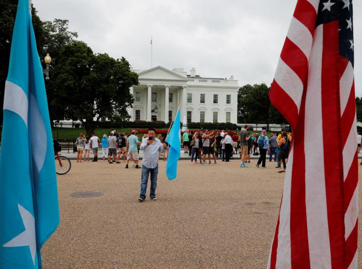 "A man demonstrates in support of the ""Uyghur people of East Turkistan"" outside the White House in Washington, U.S., August 2, 2018. REUTERS/Brian Snyder"