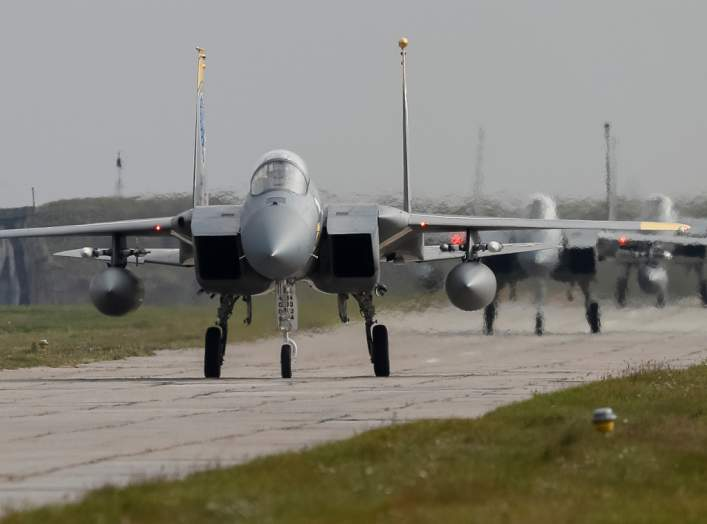 U.S. Air Force F-15 fighter jets are seen on the tarmac during the Clear Sky 2018 multinational military drills at Starokostiantyniv Air Base in Khmelnytskyi Region, Ukraine October 12, 2018. REUTERS/Gleb Garanich