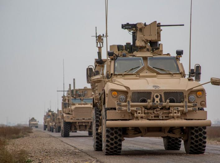 A Coalition convoy of U.S. led international coalition against the Islamic State of Iraq and the Levant (ISIL) stops to test fire their M2 machine guns and MK19 grenade launcher in the Middle Euphrates River Valley in the Deir ez-Zor province, Syria, Nove