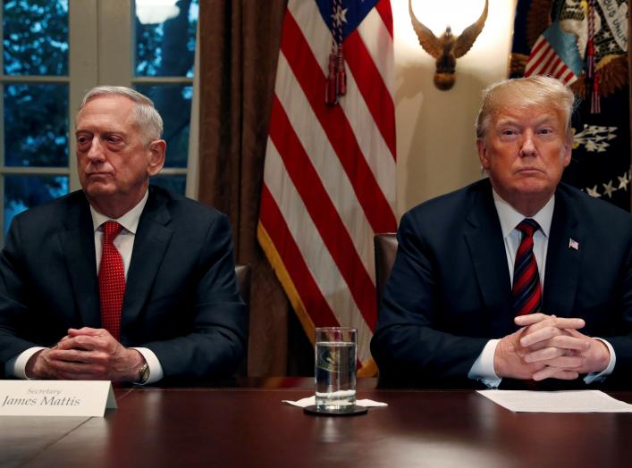 FILE PHOTO: U.S. President Donald Trump speaks to the news media while gathering for a briefing from his senior military leaders, including Defense Secretary James Mattis (L), in the Cabinet Room at the White House in Washington, U.S., October 23, 2018. R