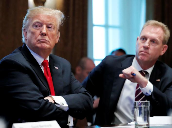 U.S. President Donald Trump listens next to Acting U.S. Defense Secretary Patrick Shanahan during a Cabinet meeting on day 12 of the partial U.S. government shutdown at the White House in Washington, U.S., January 2, 2019. REUTERS/Jim Young