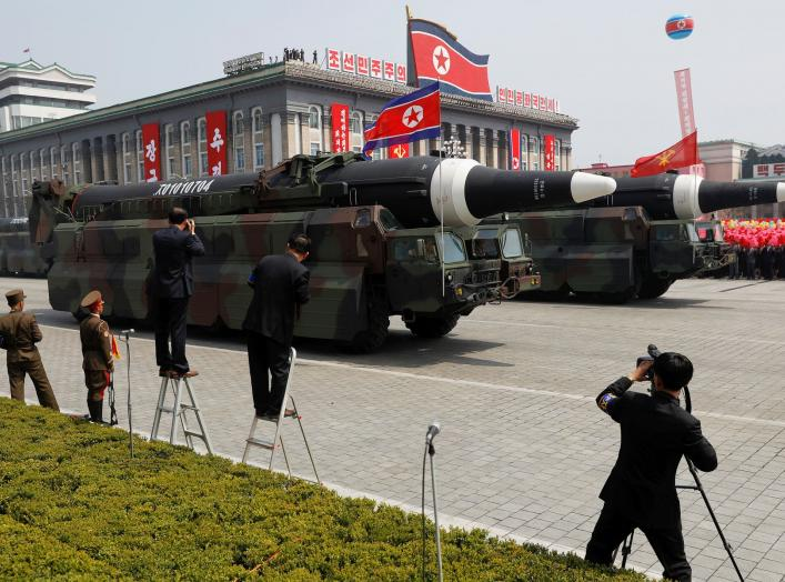 FILE PHOTO: Missiles are driven past the stand with North Korean leader Kim Jong Un and other high ranking officials during a military parade marking the 105th birth anniversary of the country's founding father Kim Il Sung, in Pyongyang April 15, 2017. RE