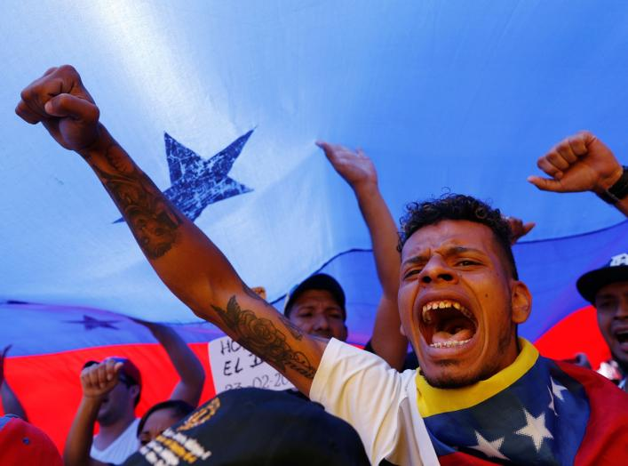 Supporters of the Venezuelan opposition leader Juan Guaido, who many nations have recognized as the country's rightful interim ruler, take part in a rally to demand President Nicolas Maduro to allow humanitarian aid to enter the country, in Caracas, Venez