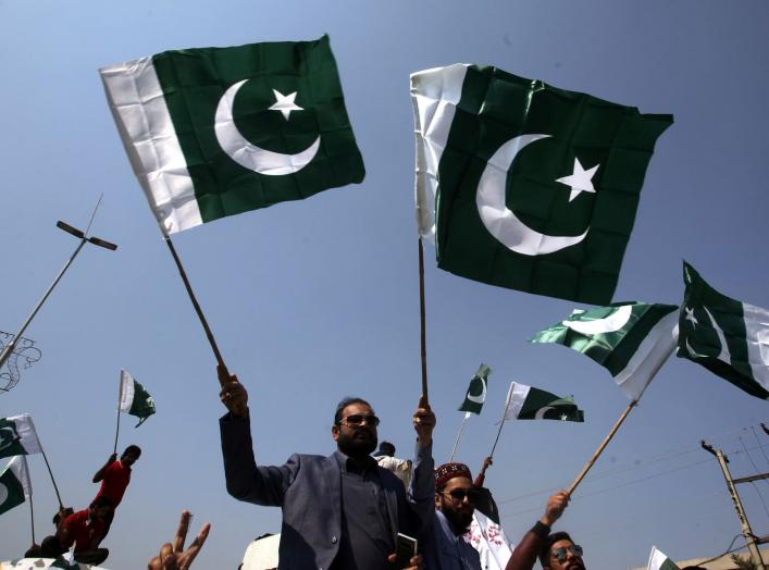 People carry national flags as they celebrate, after Pakistan shot down two Indian military aircrafts, in Lahore, Pakistan February 27, 2019. REUTERS/Mohsin Raza