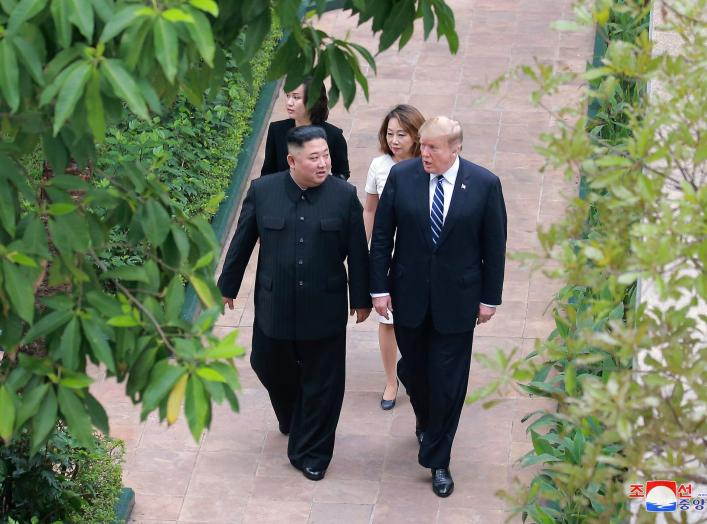 North Korea's leader Kim Jong Un walks with U.S. President Donald Trump during the second North Korea-U.S. summit in Hanoi, Vietnam, in this photo released on March 1, 2019 by North Korea's Korean Central News Agency (KCNA). KCNA via REUTERS ATTENTION EDI