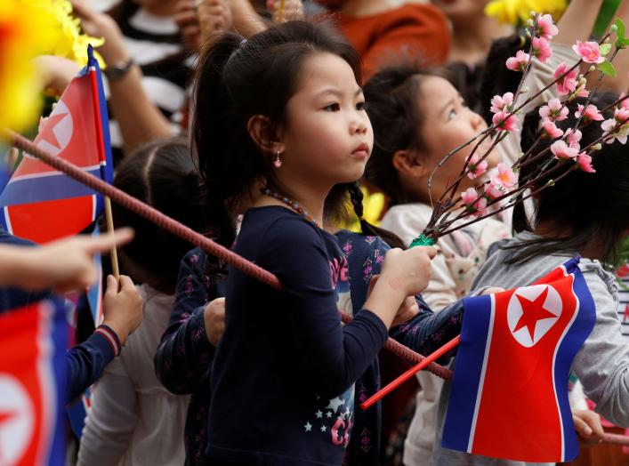 Children wait for the motorcade carrying North Korea's leader Kim Jong Un to pass, in Hanoi, Vietnam, March 1, 2019. REUTERS/Jorge Silva