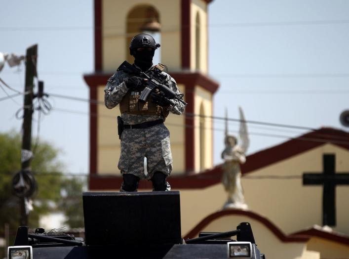 A soldier stands guard after a blockade set by members of the Santa Rosa de Lima Cartel to repel security forces during an anti-fuel theft operation in Santa Rosa de Lima, in Guanajuato state, Mexico, March 6, 2019. REUTERS/Edgard Garrido