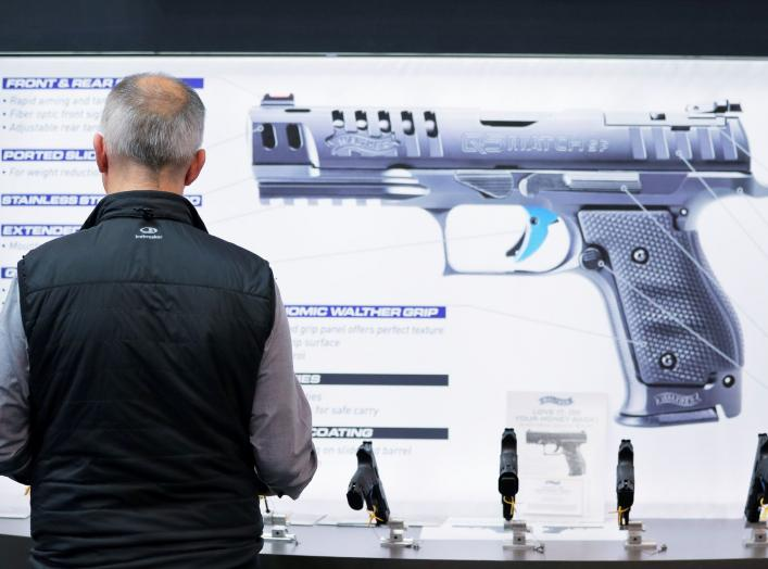 A man inspects handguns inside of the Walther booth during the National Rifle Association (NRA) annual meeting in Indianapolis, Indiana, U.S., April 28, 2019. REUTERS/Lucas Jackson