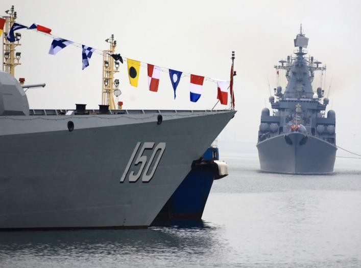 Russia Navy's guided missile cruiser Varyag (R) arrives for the Chinese-Russian joint naval exercise, near a guided missile destroyer Changchun (DDG150) of Chinese People's Liberation Army (PLA) Navy, at Dagang port, in Qingdao, Shandong province, China A