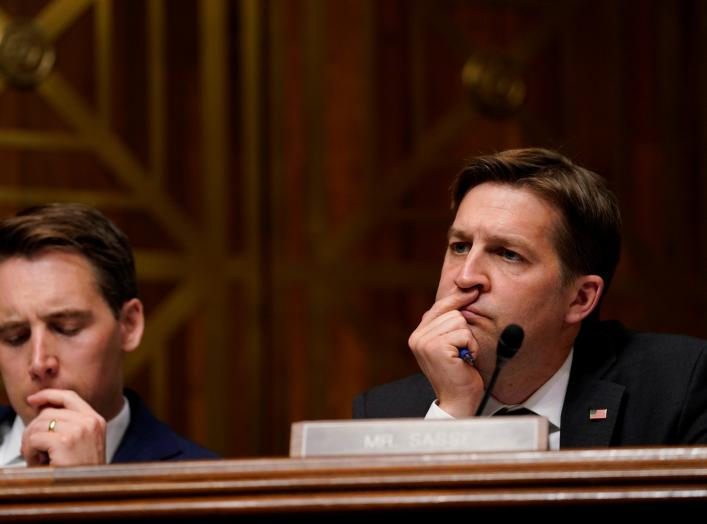 "Sen. Ben Sasse (R-NE), at right, and Sen. Josh Hawley (R-M0), look on as U.S. Attorney General William Barr testifies before a Senate Judiciary Committee hearing entitled ""The Justice Department's Investigation of Russian Interference"