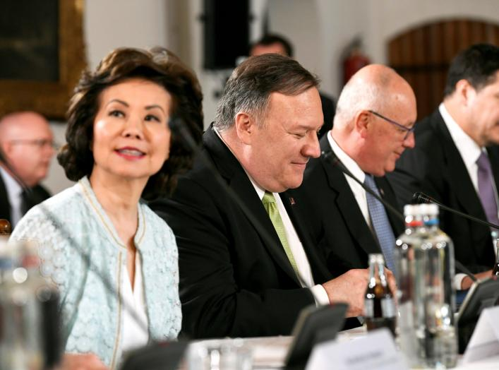 U.S. Secretary of State Mike Pompeo looks on next to U.S. Secretary of Transportation Elaine Chao during a CEO meeting in The Hague, Netherlands June 3, 2019. REUTERS/Piroschka Van De Wouw