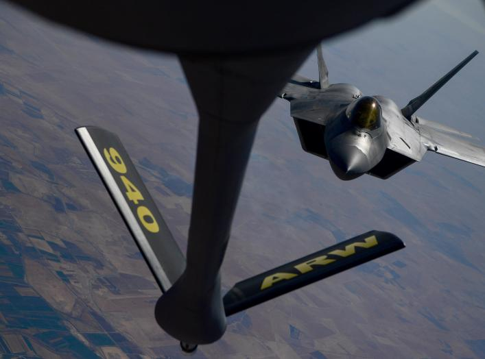 A U.S. Air Force F-22 Raptor, prepares to connect with a KC-135 Stratotanker during an aerial refueling mission above an undisclosed location, out of Al Udeid Air Base, Qatar, in this undated handout picture released by U.S. Air Force on July 29, 2019.
