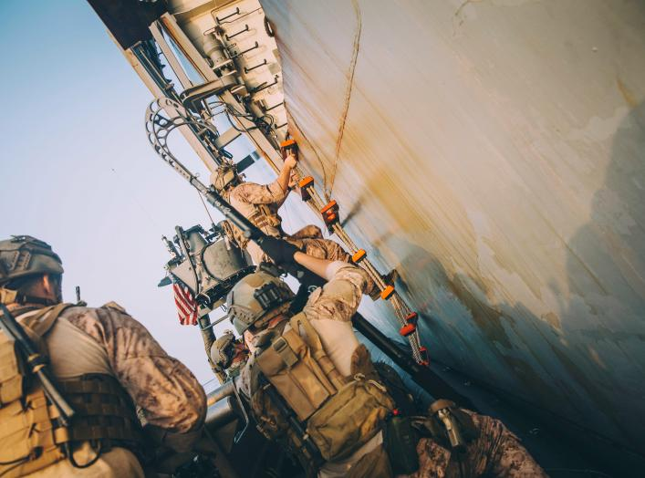 Marines with the Maritime Raid Force, 11th Marine Expeditionary Unit (MEU) climb a ladder to board the amphibious transport dock ship USS John P. Murtha (LPD 26) during a visit, board, search and seizure training exercise in the Gulf, in this undated