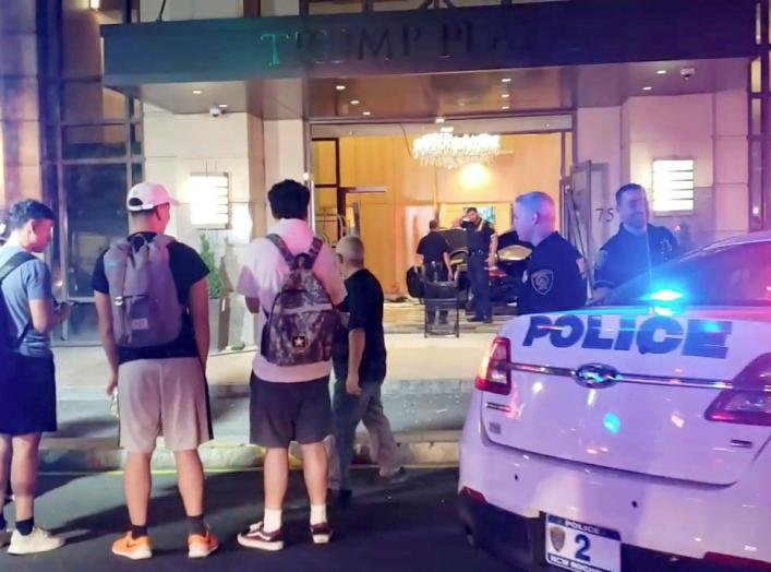 People and police officers stand outside Trump Plaza after a car crashed into the building's lobby in New Rochelle, New York, U.S., September 17, 2019, in this still image from video obtained via social media. Jose Abarca via REUTERS