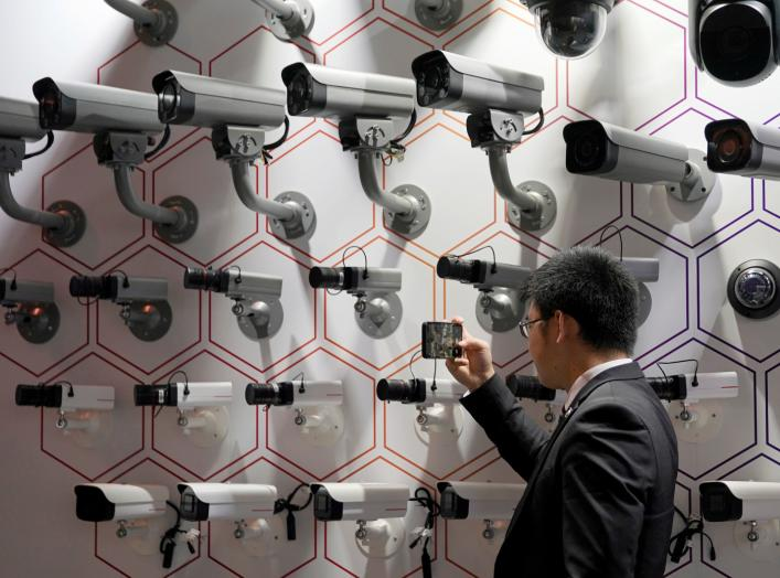 A man looks at surveillance cameras at the annual Huawei Connect event in Shanghai, China September 18, 2019. REUTERS/Aly Song