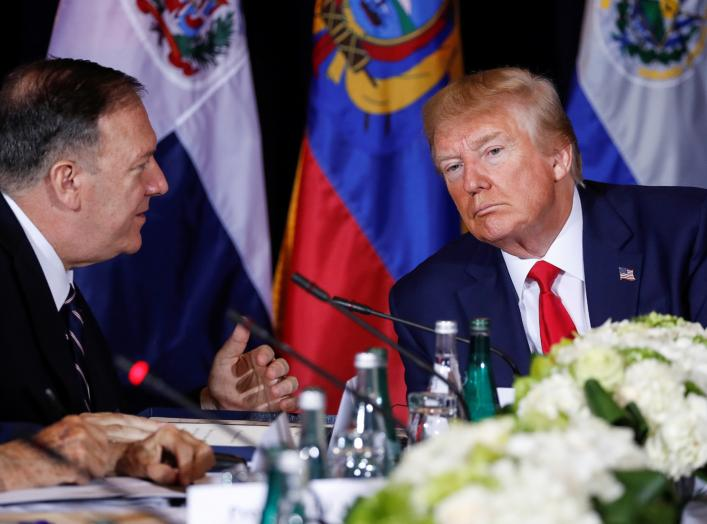 U.S. President Donald Trump confers with U.S. Secretary of State Mike Pompeo during a multilateral meeting with Western Hemisphere leaders about Venezuela during the 74th session of the United Nations General Assembly (UNGA) at U.N. headquarters.