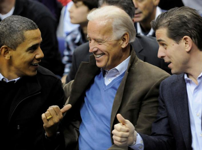 U.S. President Barack Obama, Vice President Joe Biden and his son Hunter Biden attend an NCAA basketball game between Georgetown University and Duke University in Washington, U.S., January 30, 2010. Picture taken January 30, 2010. REUTERS/Jonathan Ernst