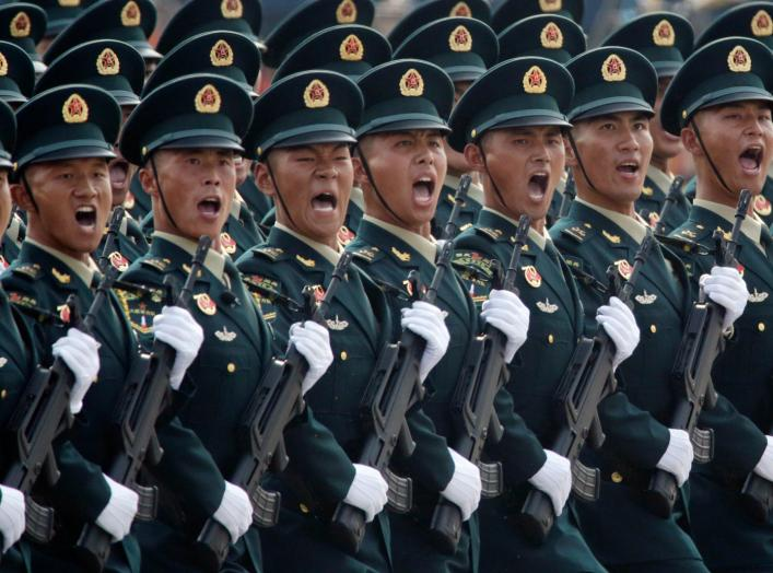 Soldiers of People's Liberation Army (PLA) march in formation past Tiananmen Square during the military parade marking the 70th founding anniversary of People's Republic of China, on its National Day in Beijing, China October 1, 2019. REUTERS/Jason Lee