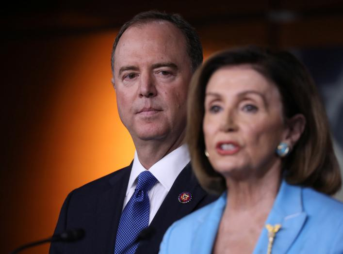 U.S. House Speaker Nancy Pelosi (D-CA) addresses reporters as House Intelligence Committee Chairman Adam Schiff (D-CA) looks on during Pelosi's weekly news conference at the U.S. Capitol in Washington, U.S., October 2, 2019. REUTERS/Jonathan Ernst