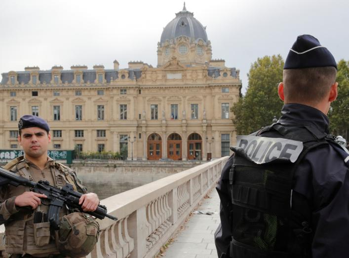 French police secure the area in front of the Paris Police headquarters in Paris, France, October 3, 2019. REUTERS/Philippe Wojazer