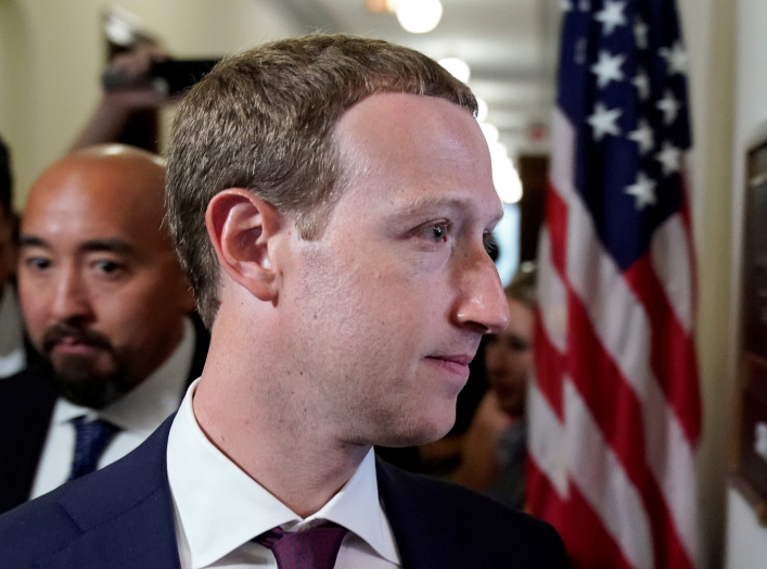 "Facebook Chief Executive Mark Zuckerberg enters the office of U.S. Senator Josh Hawley (R-MO) while meeting with lawmakers to discuss ""future internet regulation on Capitol Hill in Washington, U.S., September 19, 2019. REUTERS/Joshua Roberts"