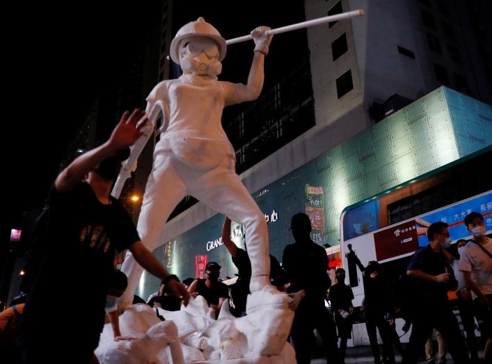 A 4m tall 'Statue of Lady Liberty Hong Kong' is seen during a demonstration after a government's ban on face masks under emergency law, at Mong Kok, in Hong Kong, China, October 4, 2019. REUTERS/Tyrone Siu
