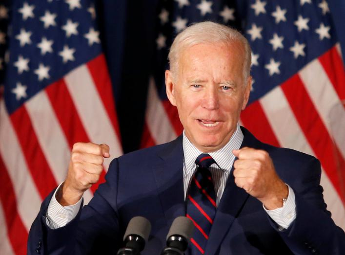 Democratic 2020 U.S. presidential candidate and former Vice President Joe Biden pumps his fists as he speaks at a campaign town hall meeting in Rochester, New Hampshire, U.S., October 9, 2019. REUTERS/Mary Schwalm