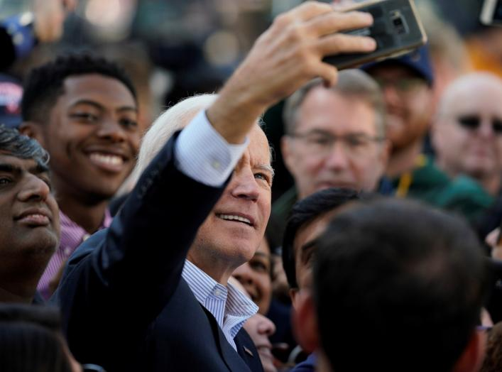 "Democratic presidential candidate and former Vice President Joe Biden takes selfies with supporters at a ""Get out the Vote"" event in Sterling, Virginia, U.S., November 3, 2019. REUTERS/Aaron P. Bernstein"