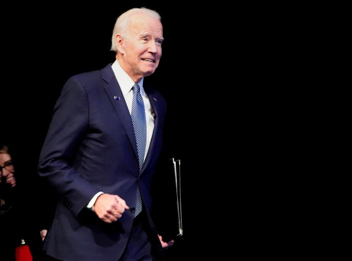 U.S. Democratic presidential candidate and former Vice President Joe Biden runs on stage at a First in the West Event at the Bellagio Hotel in Las Vegas, Nevada, U.S., November 17, 2019. REUTERS/Carlo Allegri