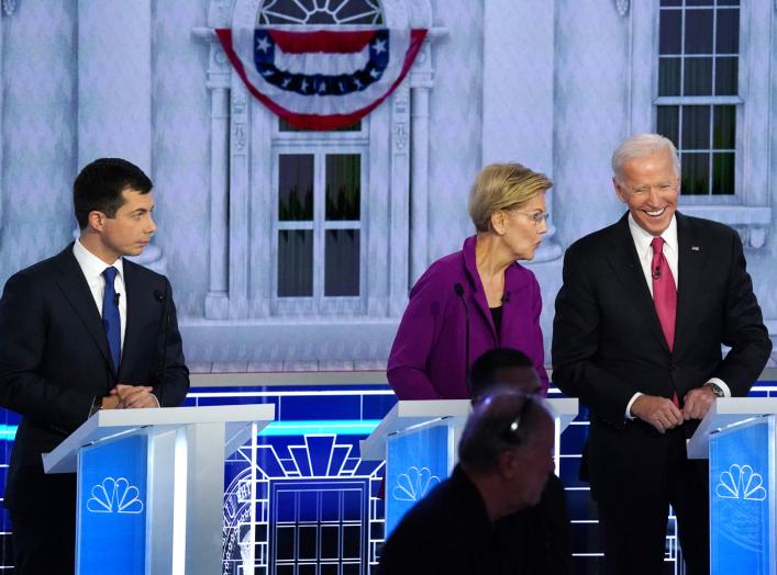 South Bend Mayor Pete Buttigieg looks on as Senator Elizabeth Warren and former Vice President Joe Biden talk during a break in the U.S. Democratic presidential candidates debate at the Tyler Perry Studios in Atlanta, Georgia, U.S. November 20, 2019.
