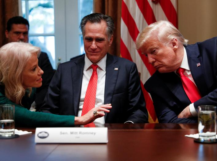 From left: White House counselor Kellyanne Conway speaks to Senator Mitt Romney (R-UT) and U.S. President Donald Trump, during a listening session on youth vaping and the electronic cigarette epidemic inside the Cabinet Room at the White House