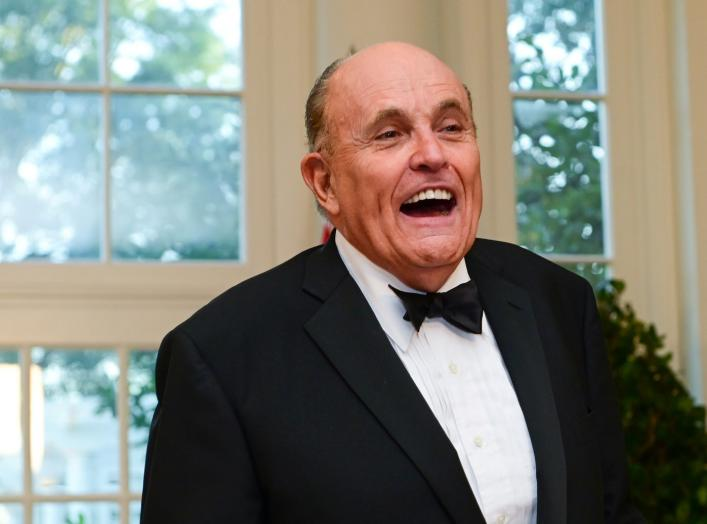 FILE PHOTO: Rudy Giuliani arrives for a State Dinner for Australia's Prime Minister Scott Morrison at the White House in Washington, U.S. September 20, 2019. REUTERS/Erin Scott/File Photo