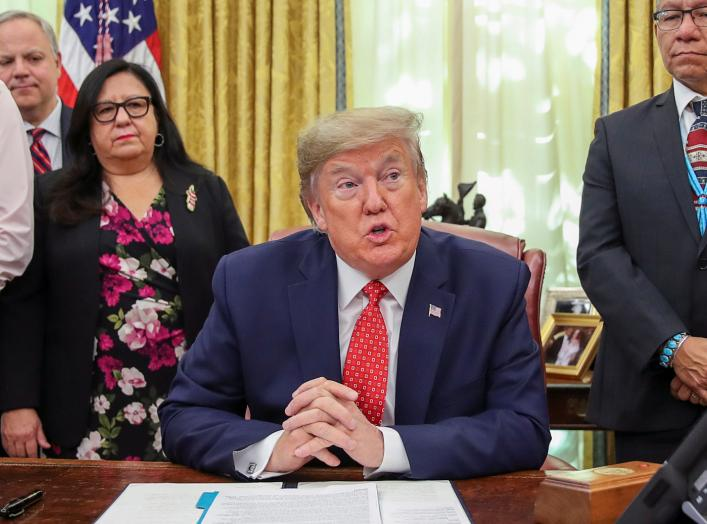 "U.S. President Donald Trump speaks while signing an Executive Order ""Establishing the Task Force on Missing and Murdered American Indians and Alaska Natives"" in the Oval Office of the White House in Washington, U.S., November 26, 2019. REUTERS/Jonathan Er"