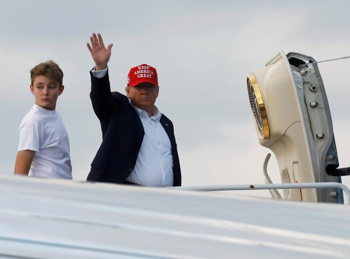 U.S. President Donald Trump and his son Barron board Air Force One en route to Washington after a Thanksgiving vacation, at Palm Beach International Airport in Florida, U.S., December 1, 2019. REUTERS/Yuri Gripas