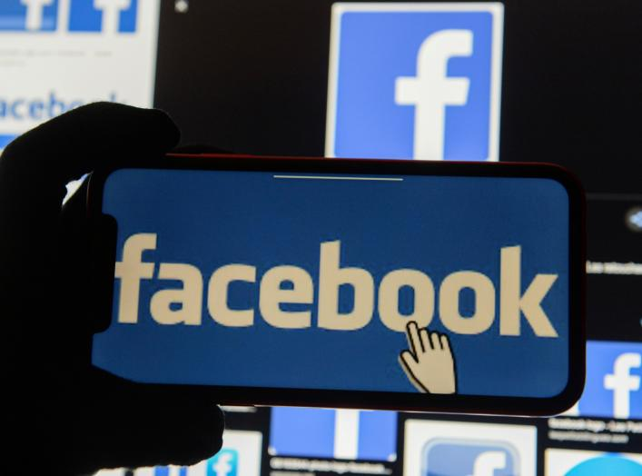 The Facebook logo is displayed on a mobile phone in this picture illustration taken December 2, 2019. REUTERS/Johanna Geron