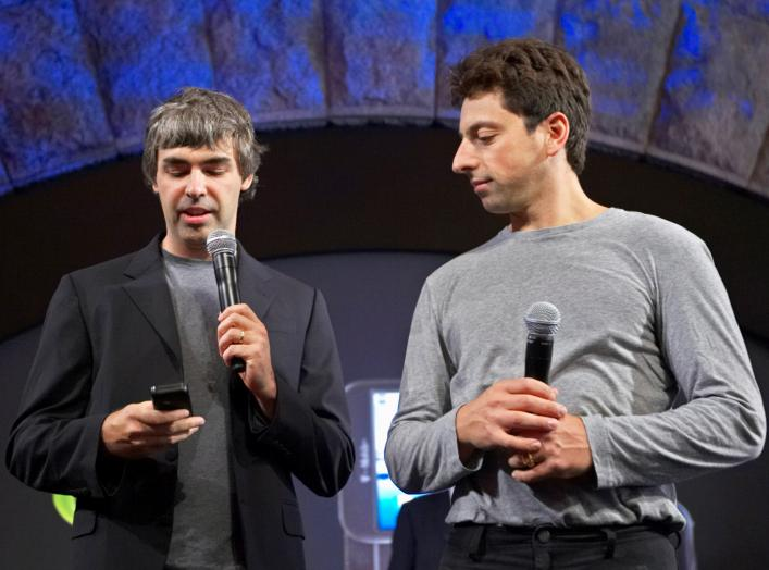 Larry Page (L) and Sergey Brin, co-founders of Google, show the new G1 phone running Google's Android software in New York September 23, 2008. REUTERS/Jacob Silberberg