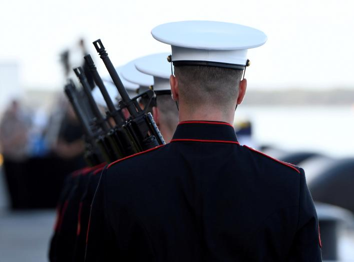 "U.S. Marines prepare for the ""Rifle Salute"" during ceremonies marking the 75th anniversary of the attack on Pearl Harbor at Kilo Pier on Joint Base Pearl Harbor - Hickam in Honolulu, Hawaii December 7, 2016. REUTERS/Hugh Gentry"