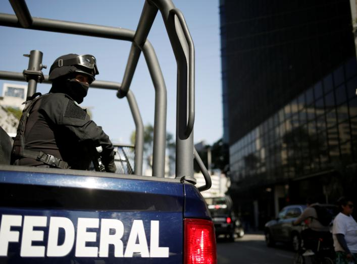 A federal police officer keeps watch after the U.S. Attorney General William Barr's convoy arrived at the Mexico's Attorney General Office (FGR) ahead of his meeting with the Mexican Attorney General Alejandro Gertz Manero, in Mexico City, Mexico