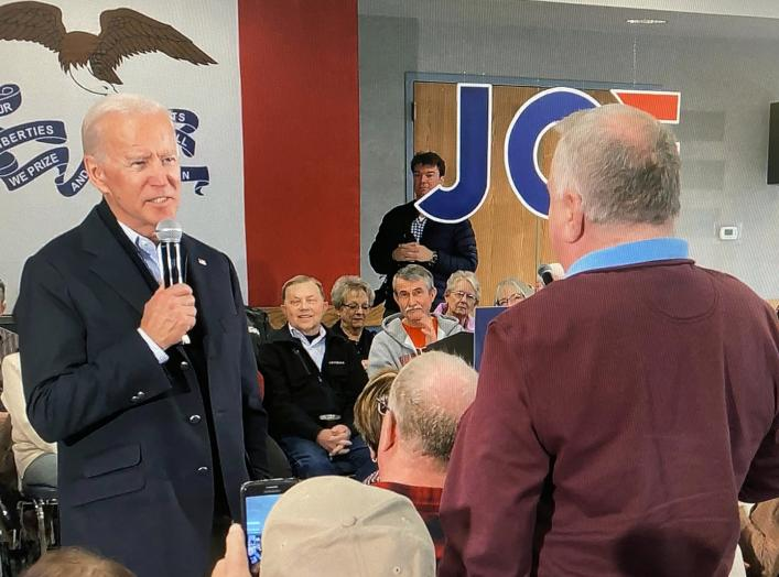 Democratic 2020 U.S. presidential candidate and former U.S. Vice President Joe Biden faces off with a local resident challenging him about his son Hunter Biden's involvement with Ukraine in this screen grab made from video shot during a Biden campaign eve