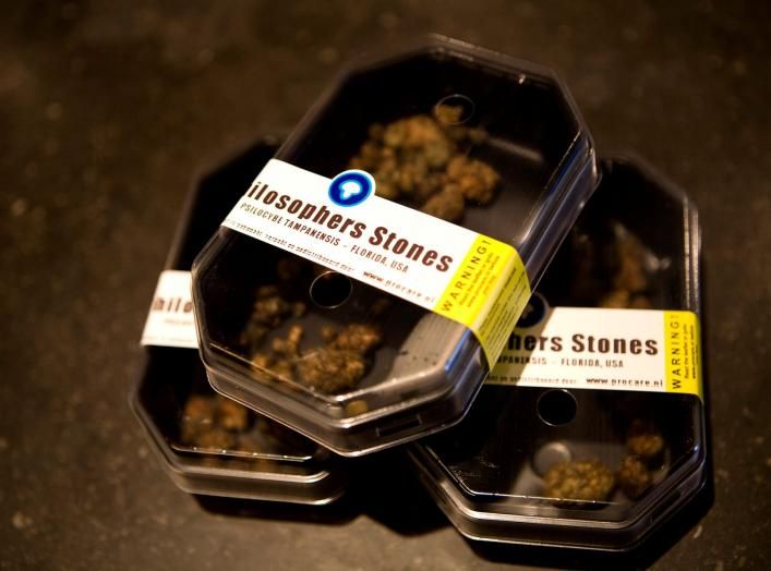 "Boxes containing magic mushrooms sit on a counter at a coffee and smart shop in Rotterdam November 28, 2008. The Netherlands will ban the sale and cultivation of all hallucinogenic ""magic"" mushrooms from next week, the latest target of a country seeking t"