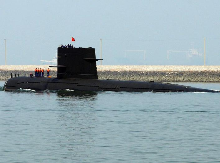 A Chinese navy submarine leaves Qingdao Port, Shandong province April 22, 2009. China will show off its resurgent naval strength this week at a parade marking 60 years since the founding of its navy, presenting its fleet of warships and nuclear submarines