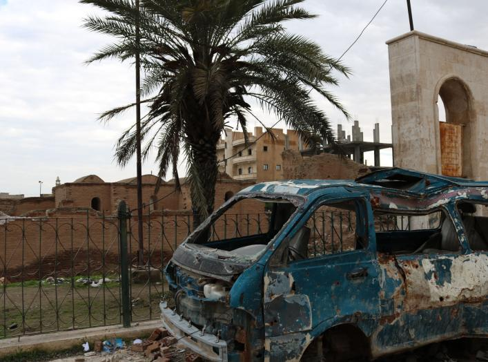 Image by Samuel Sweeney taken in Raqqa on December 11, 2018. A bombed van in front of Qasr al-Banat, a historic site in Raqqa dating to Harun al-Rashid's caliphate which also used Raqqa as its capital, from 796 to 809 AD.