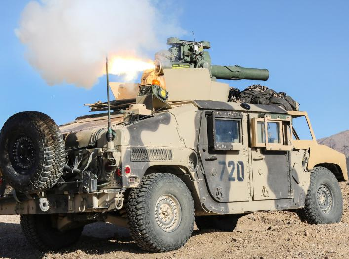 A soldier fires a Tube-launched, Optical tracked, Wire-guided missile from a Humvee, engaging Blue Force soldiers from the observation point Furlong during the Blackhorse Regiment's defense of the Whale Gap during an exercise at Fort Irwin, Calif.